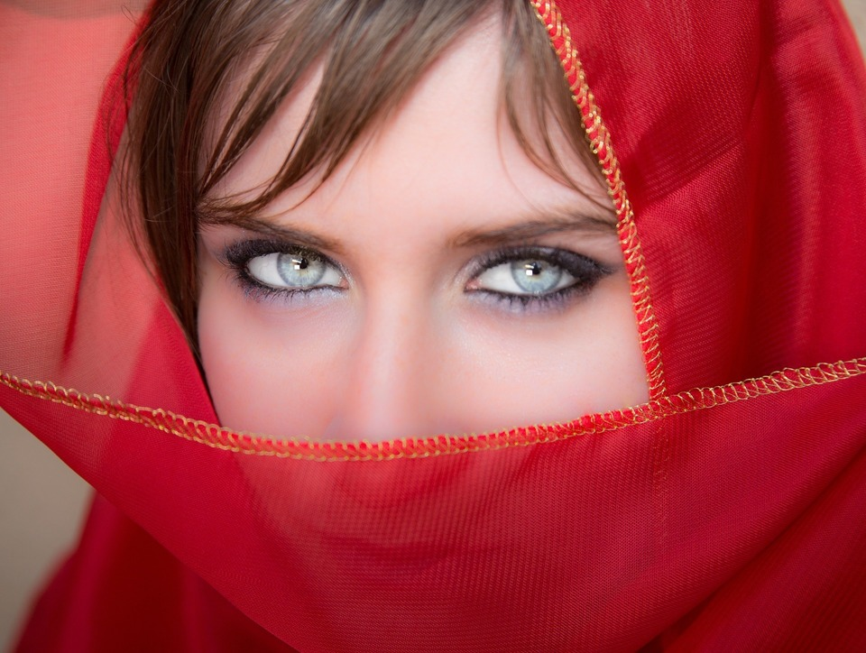 female wrapped in red scarf with pretty eyes